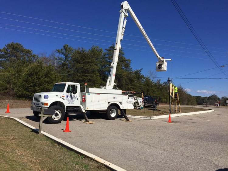 Bucket truck sign repair at Henry's in Brookwood
